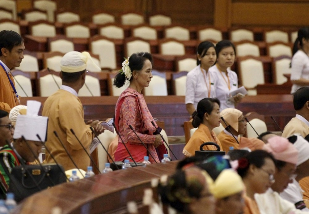Myanmar's National League for Democracy leader Aung San Suu Kyi arrives to the opening of the new parliament in Naypyitaw